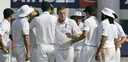 Andrew Flintoff and his teammates celebrate the dismissal of Rahul Dravid during the fifth day of the first Test match between India and England in Chennai. (AP Photo)