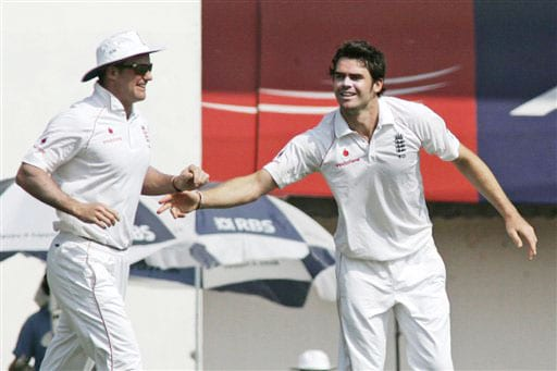 James Anderson and Andrew Strauss celebrate the dismissal of Gautam Gambhir during the fifth day of the first Test match between India and England in Chennai. (AP Photo)