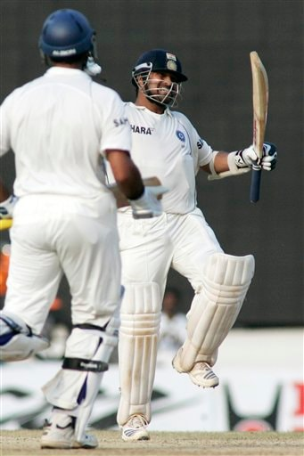 Sachin Tendulkar celebrates his century as teammate Yuvraj Singh joins him during the fifth day of the first Test match between India and England in Chennai on Monday, December 15, 2008. Tendulkar hit the winning runs and reached his 41st Test hundred with a swept boundary as India set a record for a victorious fourth-innings run chase on home soil to beat England by six wickets in the first cricket Test. (AP Photo)