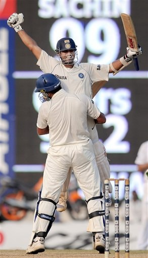 Sachin Tendulkar is congratulated by Yuvraj Singh scoring a 100 runs and winning the match on the fifth day of the first cricket Test match against in Chennai on Monday December 15, 2008. (AP Photo)