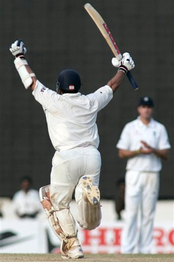 Sachin Tendulkar, left, takes a run to make a century and win over England during the fifth day of the first Test match between India and England in Chennai on Monday, December 15, 2008. (AP Photo)