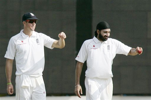 Kevin Pietersen and bowler Monty Panesar instruct fielders during the fifth day of the first Test match between India and England in Chennai. (AP Photo)
