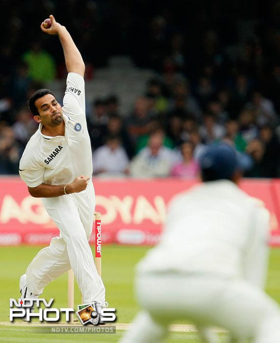 Zaheer Khan bowls to Andrew Strauss during the first day of the first Test between India and England at the Lord's Cricket ground in London. (AP Photo)