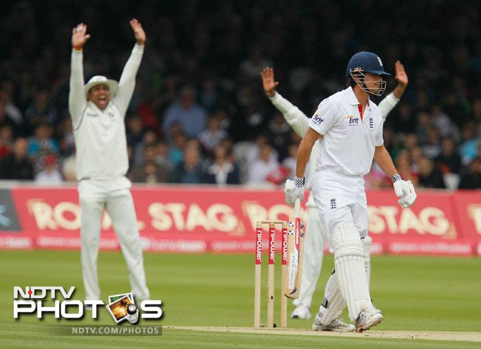 Alastair Cook survives an early lbw appeal from Praveen Kumar during the first day of the first Test at the Lord's Cricket ground in London. (AP Photo)