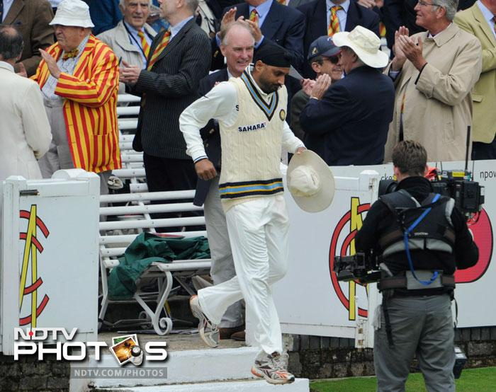 Harbhajan Singh comes onto the field before the start of play on the 1st day of the first Test match against England at the Lord's Cricket ground in London. (AP Photo)