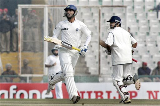 Yuvraj Singh and Gautam Gambhir run between the wickets during final day of second Test between India and England in Mohali.