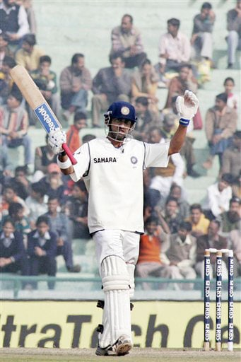 Gautam Gambhir acknowledges the crowd after scoring 50 runs during the final day of second Test between India and England in Mohali.