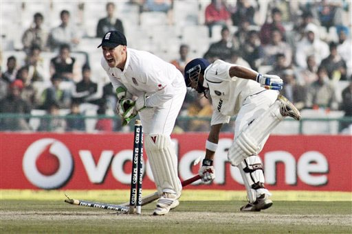 Gautam Gambhir reaches his berth as England's wicketkeeper Matt Prior shatters the wickets in an unsuccessful run out attempt during final day of second Test between India and England in Mohali.
