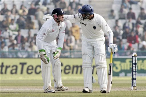 Yuvraj Singh attends to Matt Prior after he was injured by the ball during final day of second Test between India and England in Mohali.