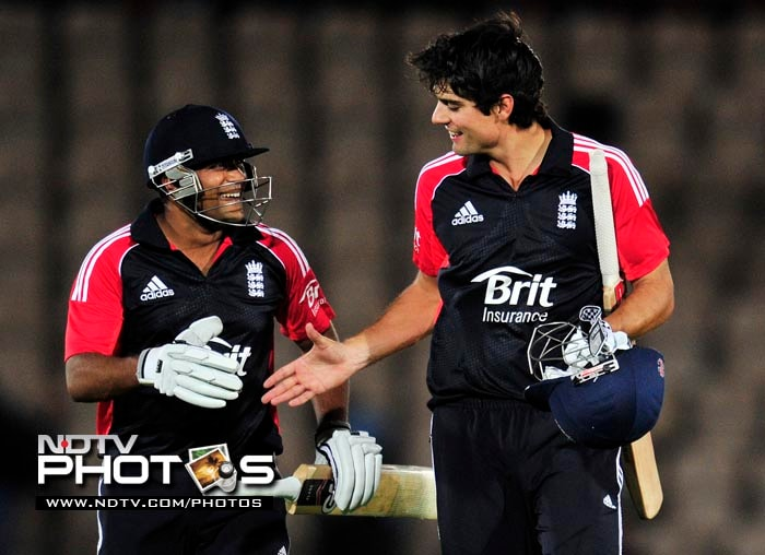 Skipper Alastair Cook's unbeaten 80 in the 2nd ODI ensured England maintained their unbeaten streak against India on the tour. England defeated India by 7 wickets in the match reduced to 23 overs a side due to rain, to take a 1-0 lead in the 5-match series. The 1st ODI had been abandoned due to rain. (AFP Photo)