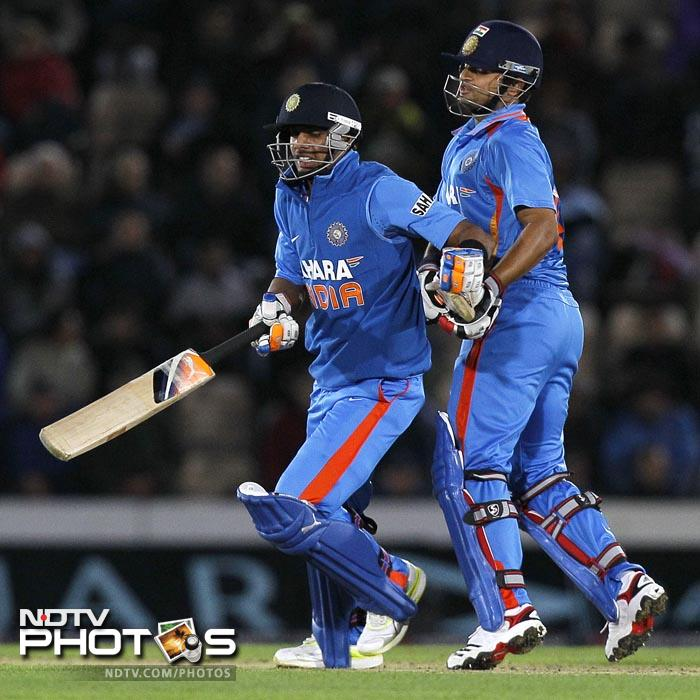 Suresh Raina, right, (40 off 19 balls) accelerated the scoring in the latter stages. Manoj Tiwary (left) played in the match despite arriving in England only on Tuesday. (AP Photo)