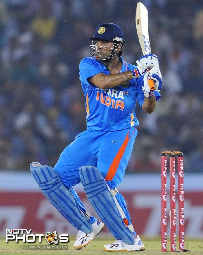 Indian captain MS Dhoni again showcased that there is hardly a better match-finisher than him. He hit the winning shot that handed India a win in the 3rd ODI and an unassailable 3-0 lead in the 5-match series. (ALL AFP and AP IMAGES)