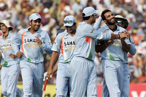 Indian cricketers congratulate teammate Zaheer Khan for the dismissal of Alistair Cook during the fifth One-Day International match between India and England in Cuttack. (AP Photo)