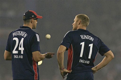 Kevin Petersen talks with teammate Andrew Flintoff during the fifth One-Day International match between India and England in Cuttack. (AP Photo)