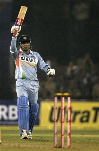Virender Sehwag acknowledges the crowd after scoring fifty runs during the fifth One-Day International match between India and England in Cuttack. (AP Photo)