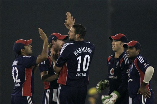 England cricketers congratulate teammate Steve Harmison for the dismissal of Sachin Tendulkar during the fifth One-Day International match between India and England in Cuttack. (AP Photo)
