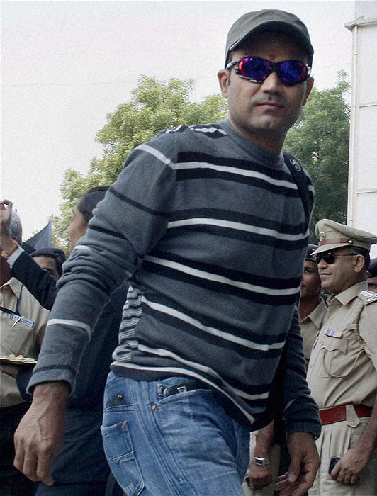 Virender Sehwag arrives in Ahmedabad for the first Test match against New Zealand at the Sardar Patel Stadium. (PTI Photo)