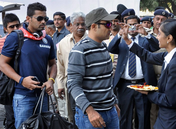 Virender Sehwag and Murli Vijay arrive for the first Test match against New Zealand, at Sardar Patel Stadium Motera in Ahmedabad. (PTI Photo)