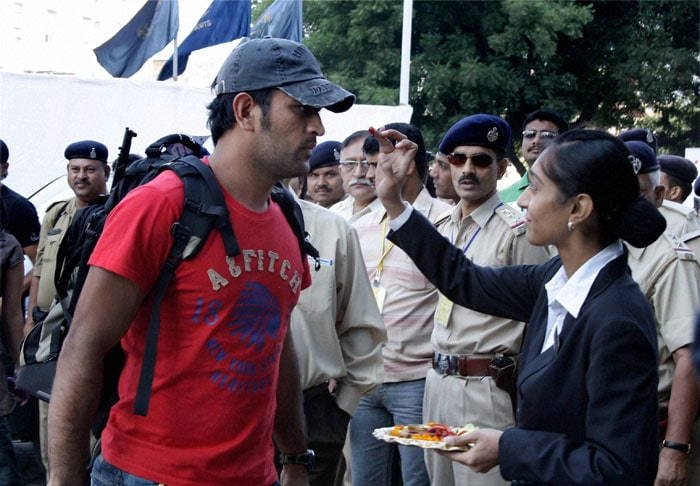 Indian team captain MS Dhoni being welcomed by hotel staff as he arrives for the first Test match against New Zealand, at Sardar Patel Stadium Motera in Ahmedabad. (PTI Photo)