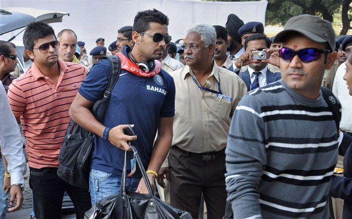 Virender Sehwag, Murli Vijay and Suresh Raina arrive for the first Test match against New Zealand, at Sardar Patel Stadium Motera in Ahmedabad. (PTI Photo)