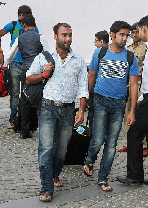 Amit Mishra and Gautam Gambhir arrive for the first Test match against New Zealand, at Sardar Patel Stadium Motera in Ahmedabad. (PTI Photo)