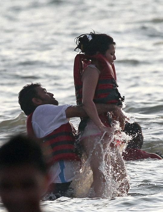 India's captain Mahendra Singh Dhoni and his wife Sakshi enjoy a light moment at Benaulim beach on Sunday. (PTI Photo)