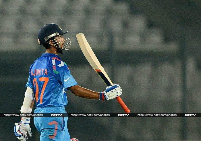 While Rahane (in pic) scored 56 off 66, Dhawan hit a 78-ball 60 before falling.