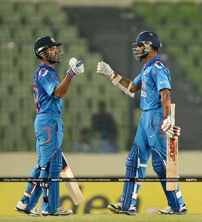 Indian openers Ajinkya Rahane (left) and Shikhar Dhawan hit fifties in reply.