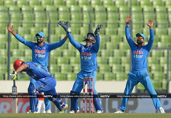 A relaxed Indian team thrashed minnows Afghanistan by 8 wickets in an inconsequential Asia Cup match to bring their campaign to an end on a pseudo high, in Mirpur. <br><br>Here are the highlights from the match. (All images courtesy AFP and AP)