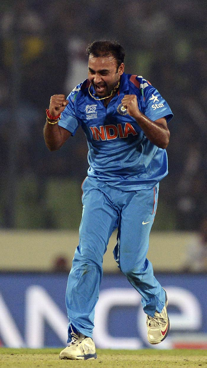 Mishra is seen celebrating one of his two wickets here. It was his spell that once again helped India tighten the noose around the opposition.