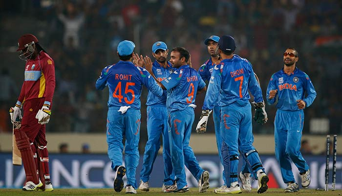 India cruised to their second win in the Super-10 stage of ICC World Twenty20. The Men in Blue defeated West Indies by 5 wickets to grab full points again, after beating Pakistan in the opener. <br><br>Here are some of the highlights...<br><br>All images courtesy AFP and AP.