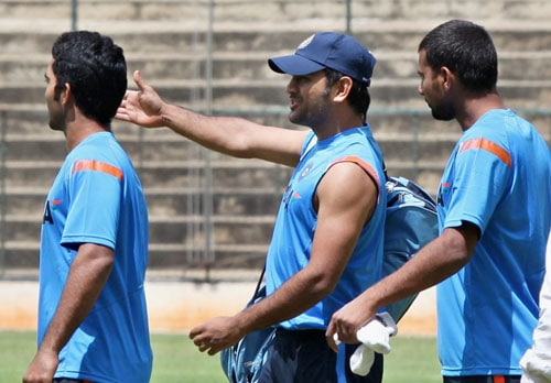 MS Dhoni, Praveen Kumar and Dinesh Karthik on the 1st day of the team's fitness and conditioning camp ahead of tri-series in Sri Lanka and Champions Trophy, in Bangalore. (PTI Photo)