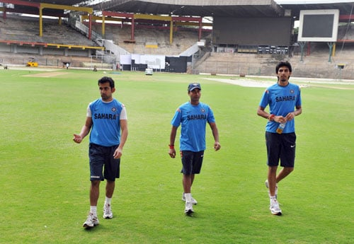 Gautam Gambhir, Amit Mishra and Ishant Sharma walk off the ground at The National Cricket Academy (NCA) at The M. Chinnaswamy Stadium in Bangalore. (AFP Photo)