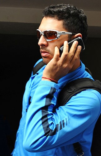 Yuvraj Singh speaks on a cellular telephone at The National Cricket Academy (NCA) at The M. Chinnaswamy Stadium in Bangalore. (AFP Photo)