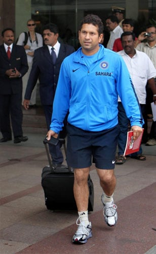 Sachin Tendulkar leaves for the team's fitness and conditioning camp, ahead of tri-series in Sri Lanka and Champions Trophy, in Bangalore. (PTI Photo)