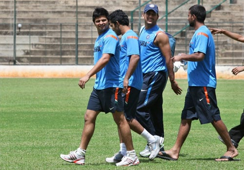MS Dhoni, Praveen Kumar, Suresh Raina and Dinesh Karthik on the 1st day of the team's fitness and conditioning camp ahead of tri-series in Sri Lanka and Champions Trophy, in Bangalore. (PTI Photo)