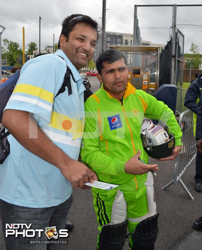 Kamran Akmal is seen here obliging a fan during the training session.