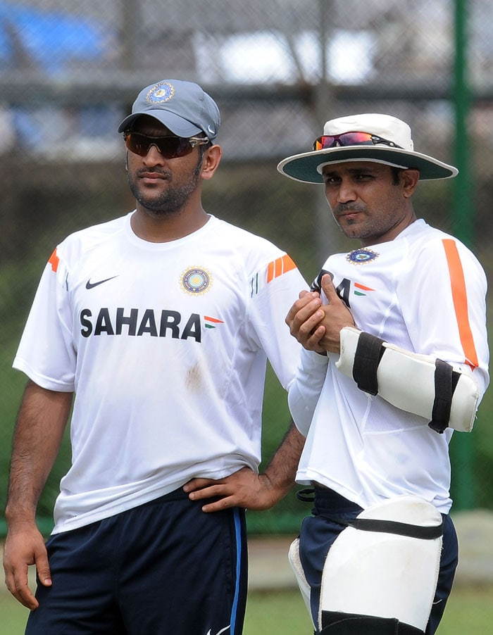 Indian captain Mahendra Singh Dhoni and teammate Virender Sehwag look on during a net practice session at the R. Premadasa Stadium in Colombo. (AFP Photo)