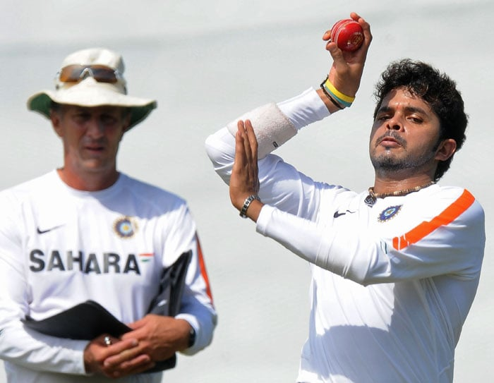 Sreesanth delivers a ball as bowling coach Eric Simmons look on during a net practice session at the R. Premadasa Stadium in Colombo. (AFP Photo)
