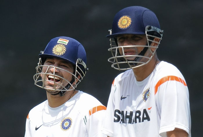 Sachin Tendulkar shares a light moment with teammate Rahul Dravid during a net practice session at the R. Premadasa Stadium in Colombo. (AFP Photo)