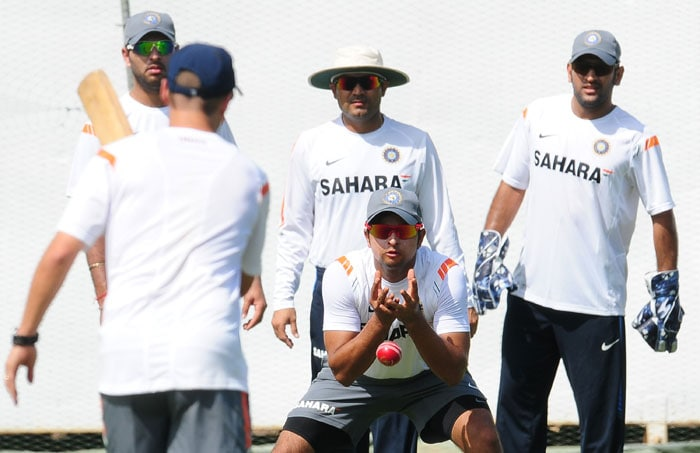 Suresh Raina catches a ball as teammates look on during a practice session at the R. Premadasa Stadium in Colombo. (AFP Photo)
