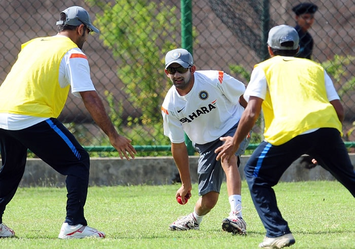 Gautam Gambhir fields a training ball as teammates looks on during a practice session at the R. Premadasa Stadium in Colombo. (AFP Photo)