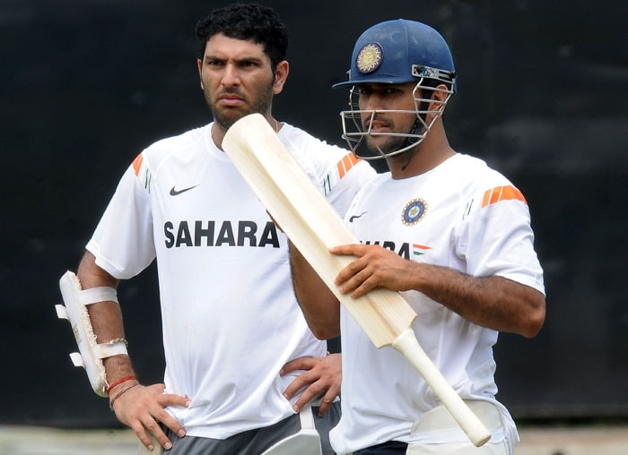 Mahendra Singh Dhoni and teammate Yuvraj Singh look on during a net practice session at the R. Premadasa Stadium in Colombo. (AFP Photo)