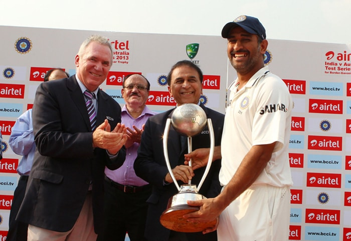 MS Dhoni was pleased as punch when he received the Border-Gavaskar Trophy from the two legends. (BCCI image)