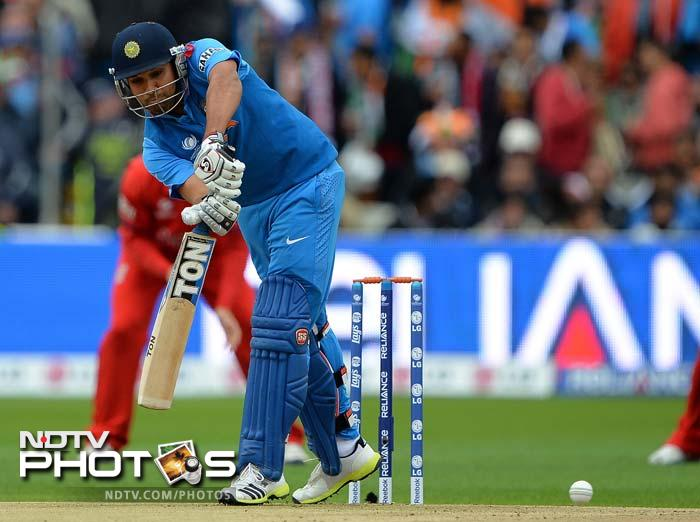 Stuart Broad struck first for England when he removed Rohit Sharma (in pic) for 9 in the fourth over.