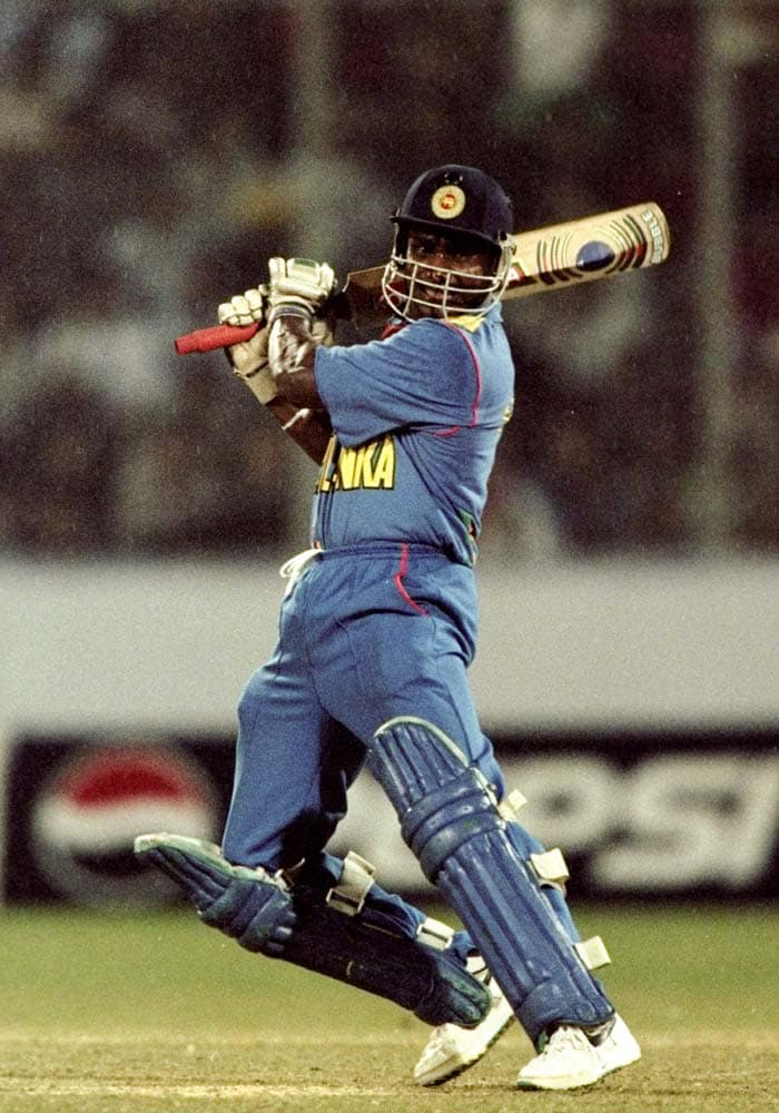 <b>October 29, 2000 (Sharjah):</b> The match will best be remembered for Sanath Jayasuriya's (in pic) thunderous knock of 189 runs. He helped his side post a daunting total of 299 but India batsmen collapsed soon after in their chase. The Lankan bowlers dismissed the opposition for a paltry 59 with Chaminda Vaas taking 5 scalps. (Getty Images)
