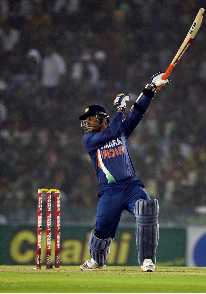 <b>December 15, 2009 (Rajkot):</b> In an incredibly high scoring match, India faced Sri Lanka at home and scored a humongous 414. Virender Sehwag (in pic) led the attack, scoring 146. Though in their reply, Tillakaratne Dilshan smashed 160 to take his team close, Indians managed to choke the attack 3 runs shot of the target. (Getty Images)