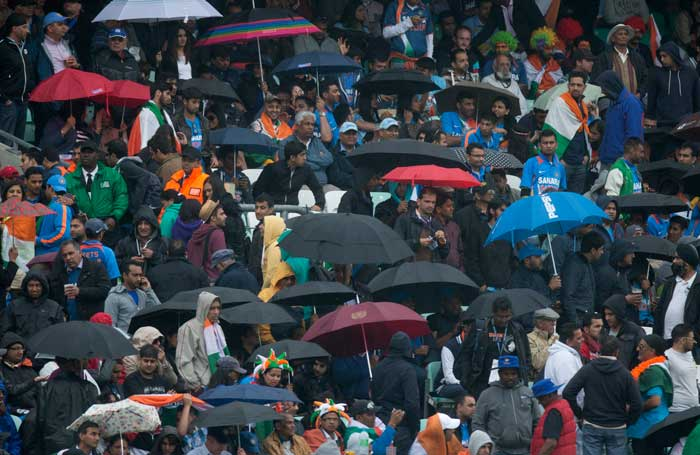 A brief rain interruption was the only hiccup as India become the first team to enter the semifinals with two wins from as many matches.