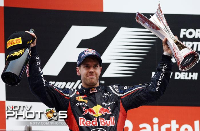 Sebastian Vettel made history repeat itself as he took top honours in the Indian Grand Prix 2012 at the Buddh International Circuit. He had won the inaugural event last year and it was full circle for the German. (All Photos AFP)