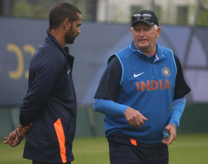 Shikhar Dhawan, the leading run getter in the tournament, is seen here taking advice from coach Duncan Fletcher.